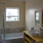 Bathroom with custom build bath tub, tiled