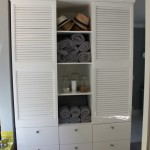 MDF cupboard spray painted high gloss with louver doors and drawers