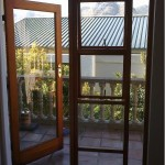 Replacing one double door with 2 opening windows and fixed glass