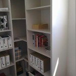 MDF corner book case, hand painted in old shower area